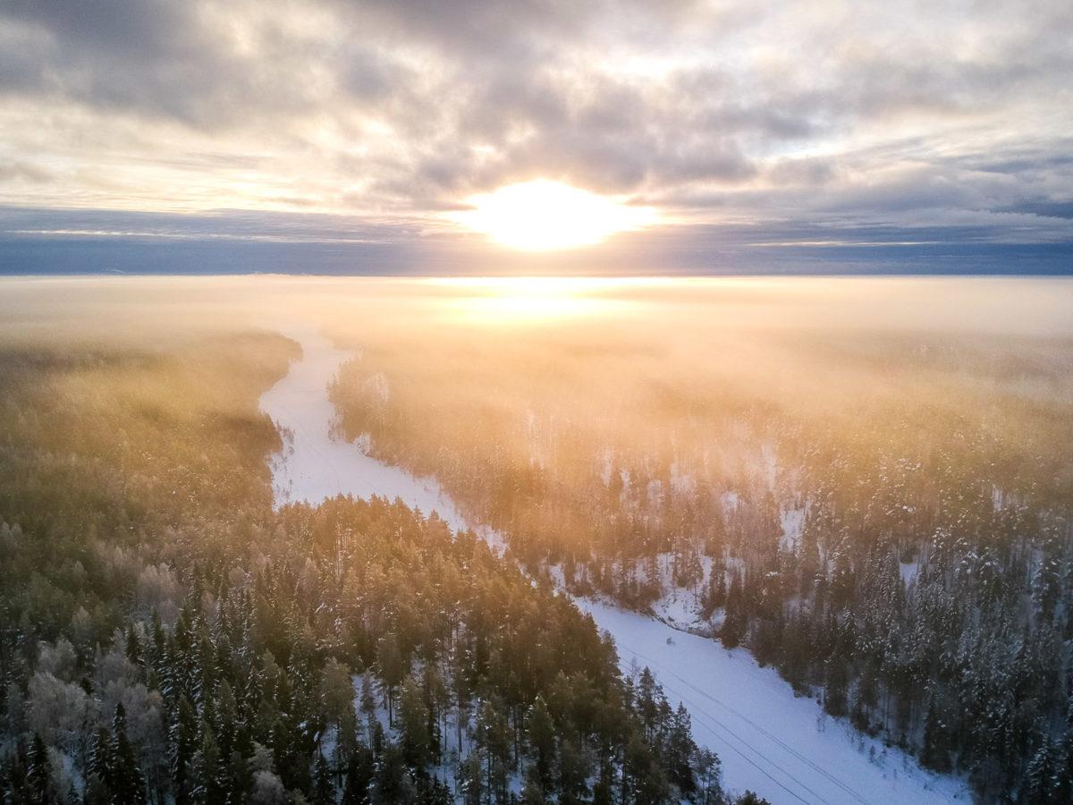Nuuksio National Park in winter. Stunning winter view over Nuuksio National Park from a drone. Finnish nature near Helsinki, Finland.