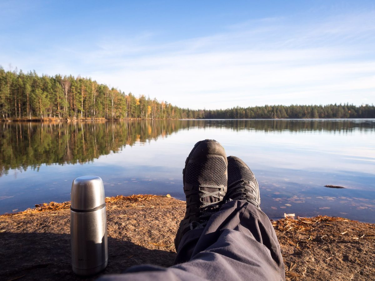 Nuuksio National Park in fall. Having my morning coffee by a beautiful lake. Nature near Helsinki, Finland.