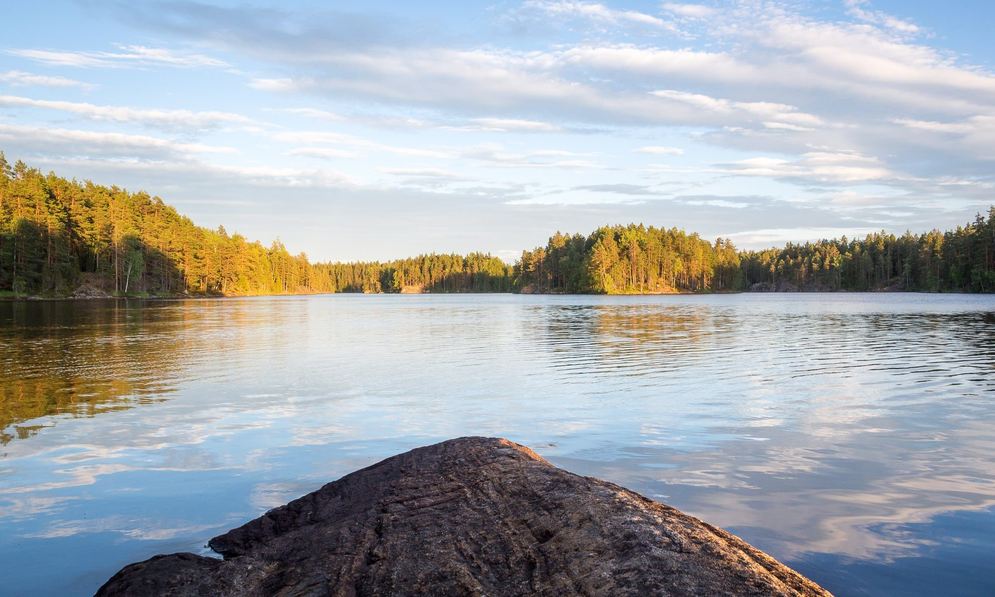 Nuuksio National Park in summer. Relax at the peaceful lakes and swim in the clear waters. Nature near Helsinki, Finland.